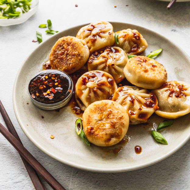 Pan-Fried Steamed Dumplings with Spicy Garlic Ginger Sauce